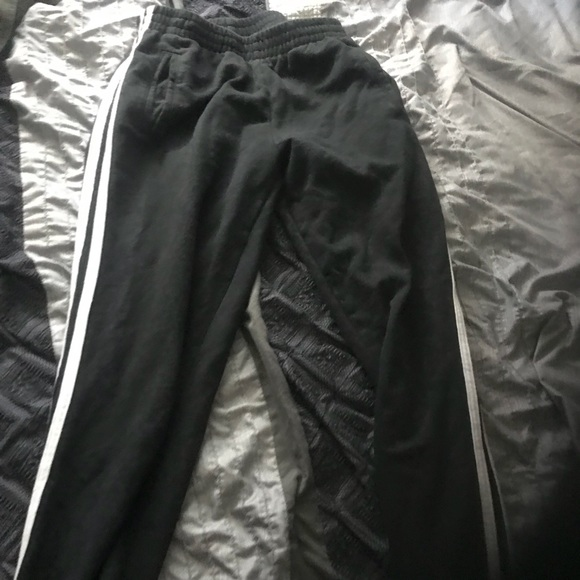 Brandy Melville Pants - Black sweat pants with white stripes